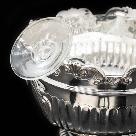 A silver monteith bowl holding a wine glass