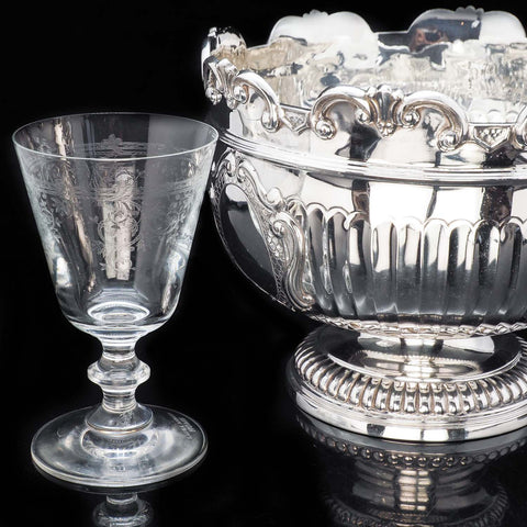 wine glass and silver bowl