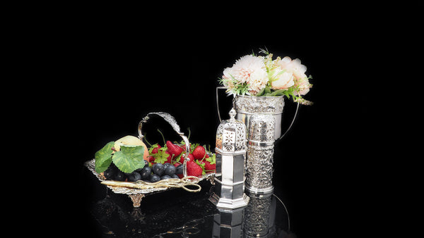 Solid silver basket and caster with fruits