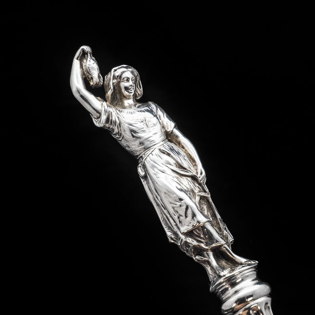 A solid silver figural fish server handle of a maiden