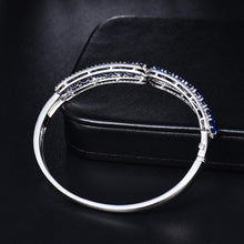 Load image into Gallery viewer, 18Kt White Gold Natural Blue Sapphire & Diamond Bangle - EK CHIC