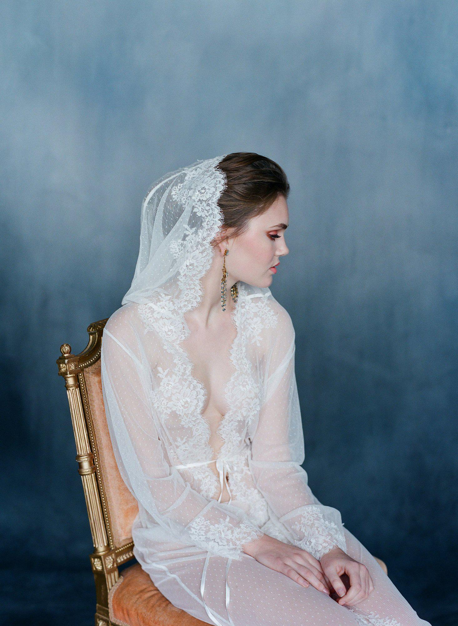 Bride wearing long lace robe