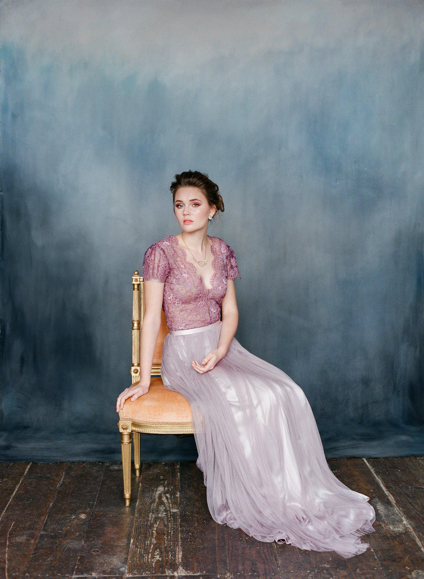 Women wearing purple silk tulle wedding dress with purple lace top