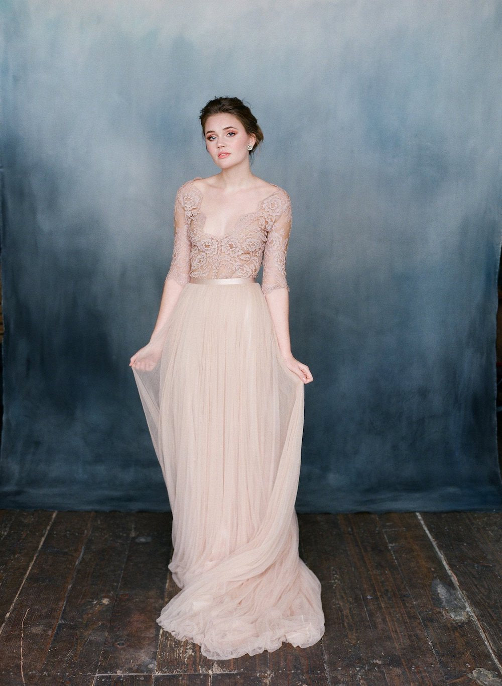 women wearing a pink silk tulle skirt with pink lace top with sleeves and v-neckline