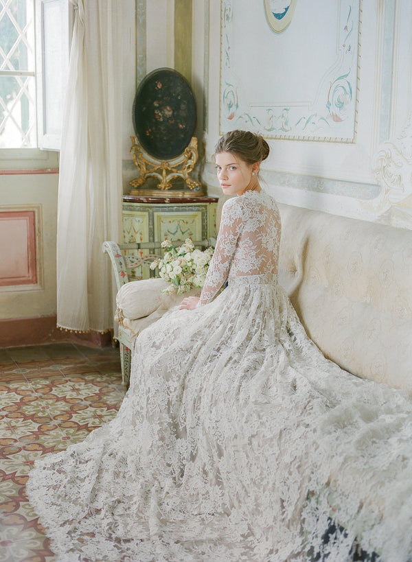 Women wearing ivory corded lace wedding dress at Villa Di Geggiano Italy.