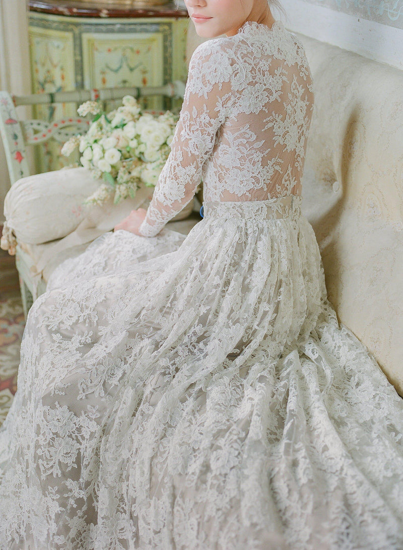 Women wearing a full lace bridal dress.