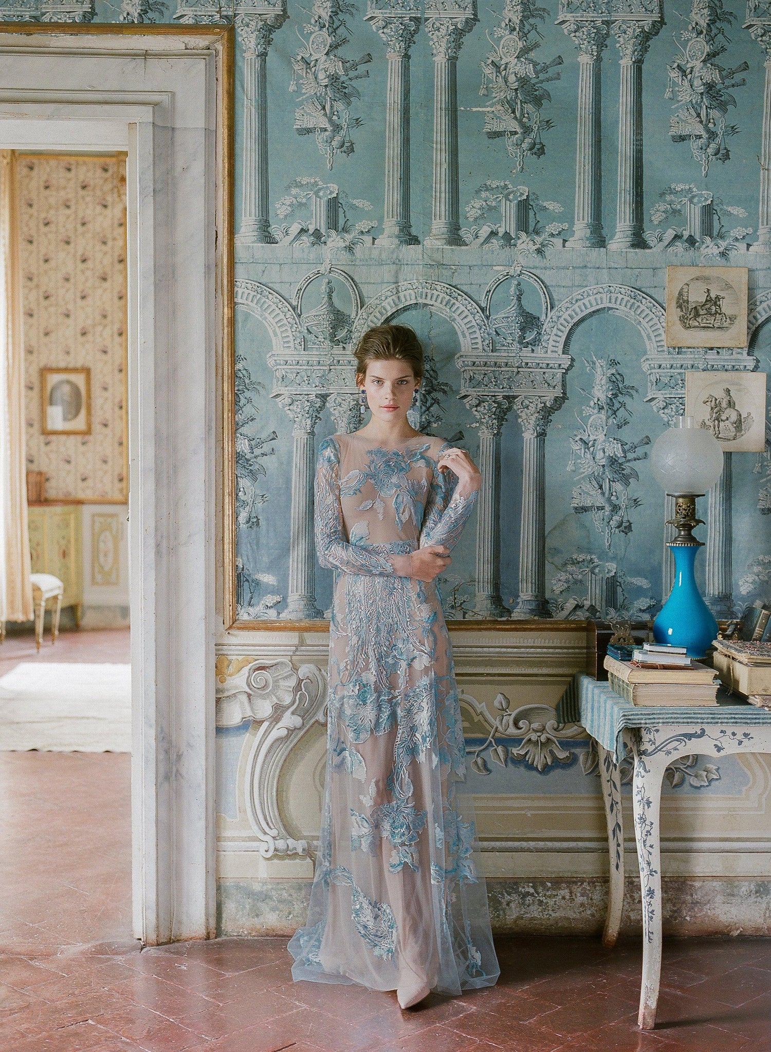 women standing wearing a blue lace dress at Villa di geggiano in Siena Italy