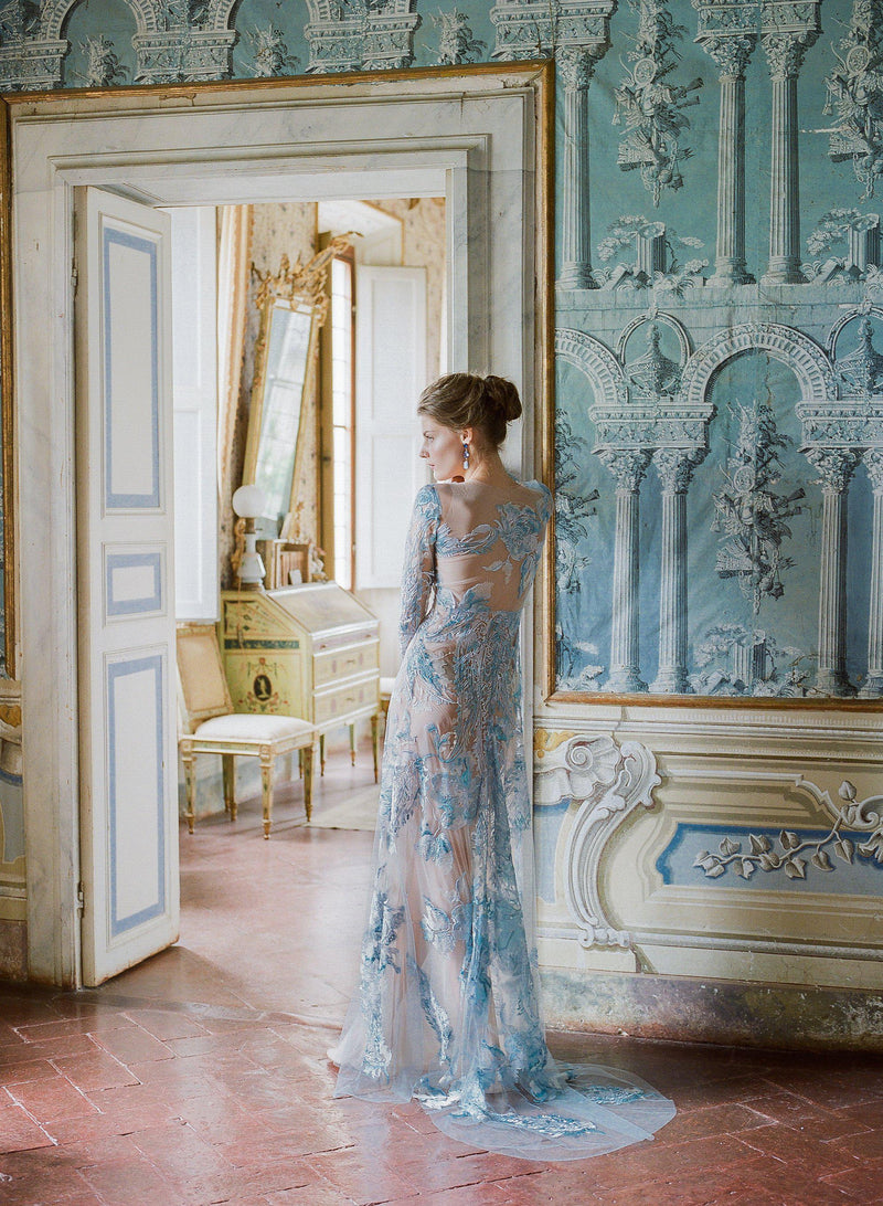 women wearing Haute Couture Blue embroidered gown at Villa di geggiano Siena Italy