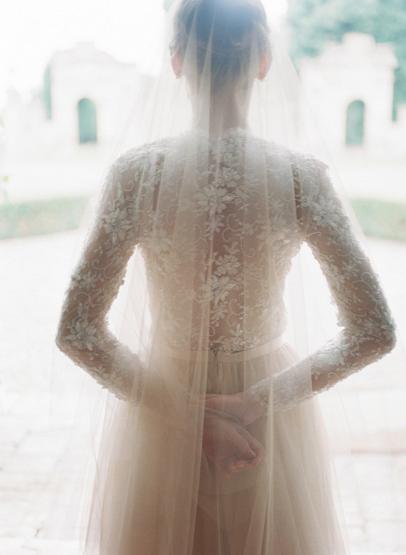 Back details of silk tulle veil and beaded lace top.
