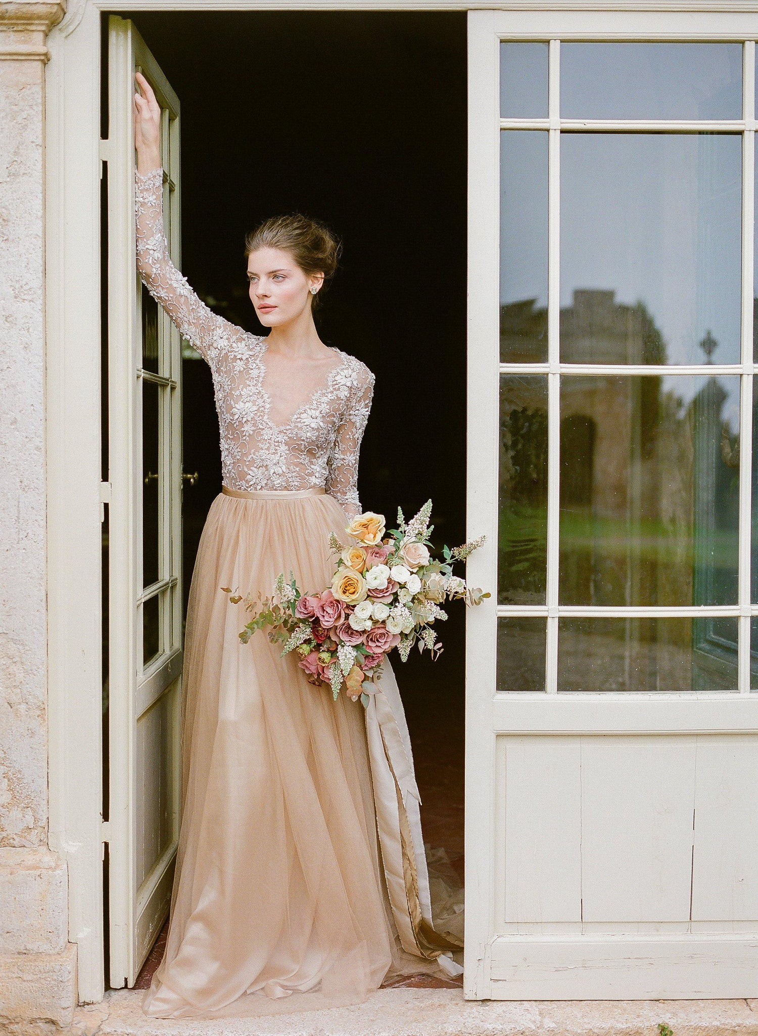 women wearing silk tulle skirt in gold and a ivory lace top.