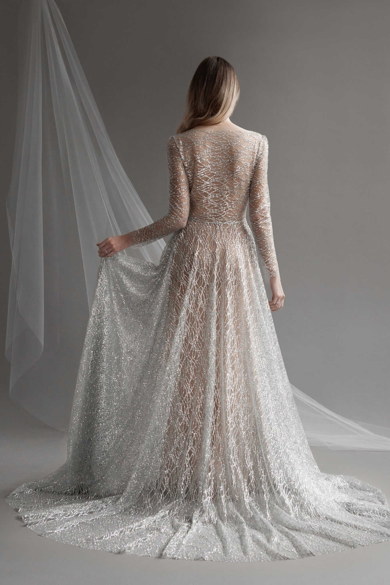 Women showing back of gray sparkle wedding dress