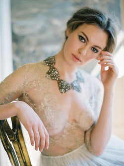 Women wearing gold lace top