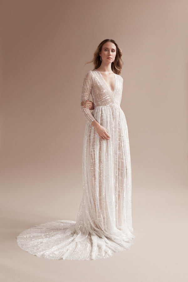 Women wearing the sparkle dress in Off-white.