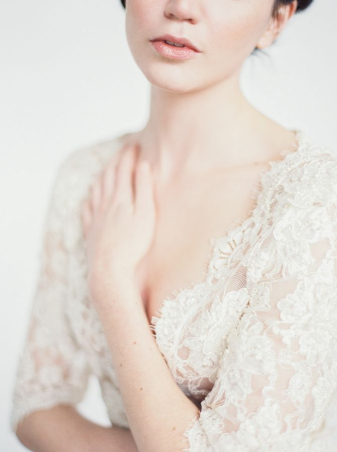 "Women wearing an ivory beaded lace top with V-neckline and 3/4""  sleeves"