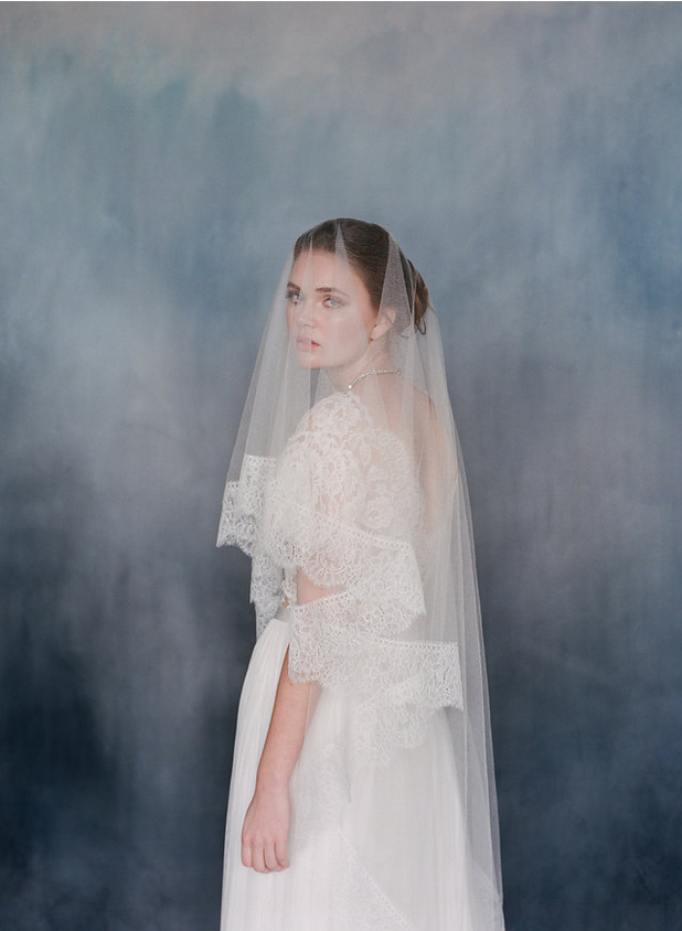 Women wearing sheer silk tulle veil with Off-white dress