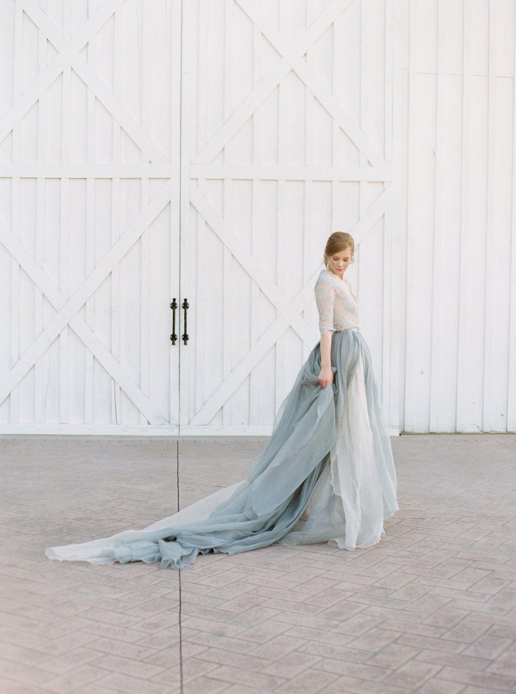 Women wearing a gray silk wedding dress wit lace sleeves