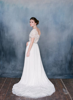 Bride wearing Off-white silk tulle dress with cathedral train and lace top.