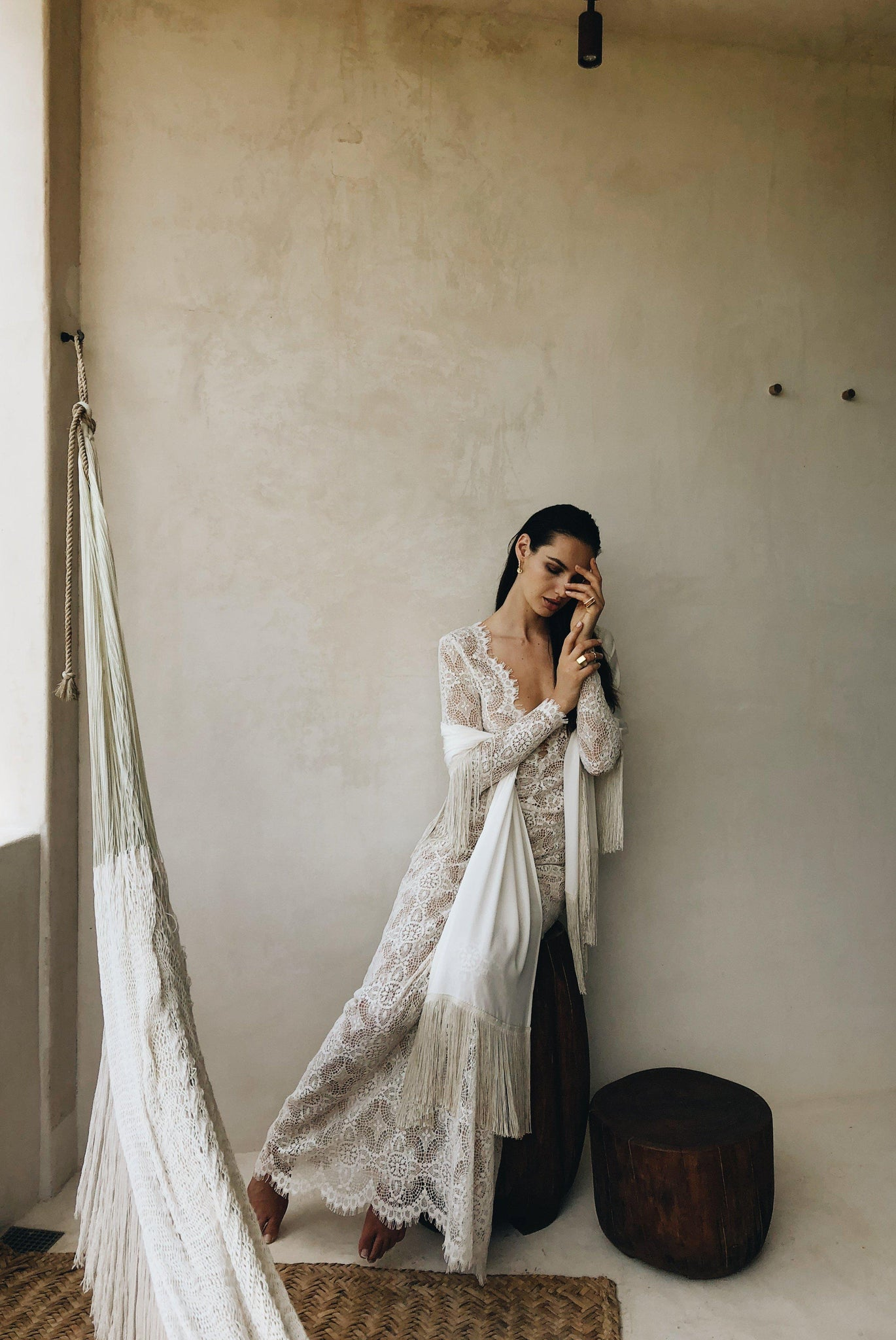 Bride wearing a lace wedding dress with Fringe shawl and wrap