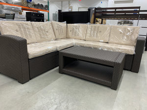Sectional patio set with coffee table