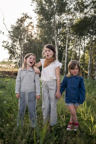 3-kids-in-Jackalo-clothing-outdoors