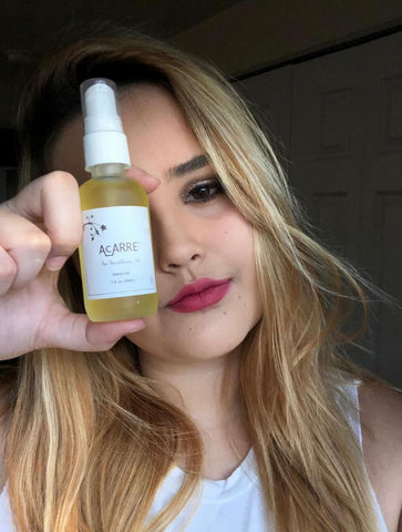 Blonde woman holding AcARRE beauty edit bottle