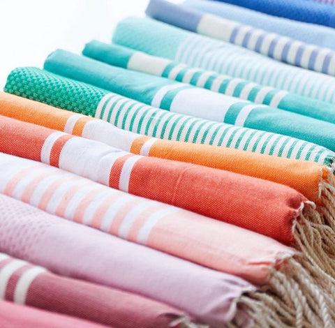Foutas or Tunisian towels come in an assortment of colors at Soukra