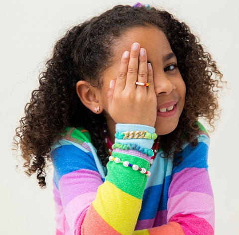 Stylish girl showing off her colorful Rosie Bold bracelets and ring