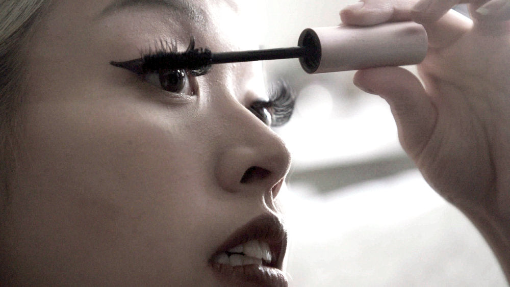 closeup of woman from toxic beauty documentary applying mascara