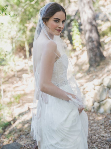woman-in-wedding-dress-outdoors