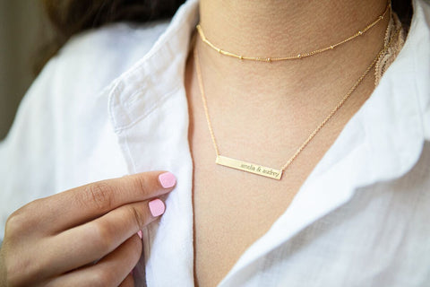 woman-wearing-tiny-tags-necklace