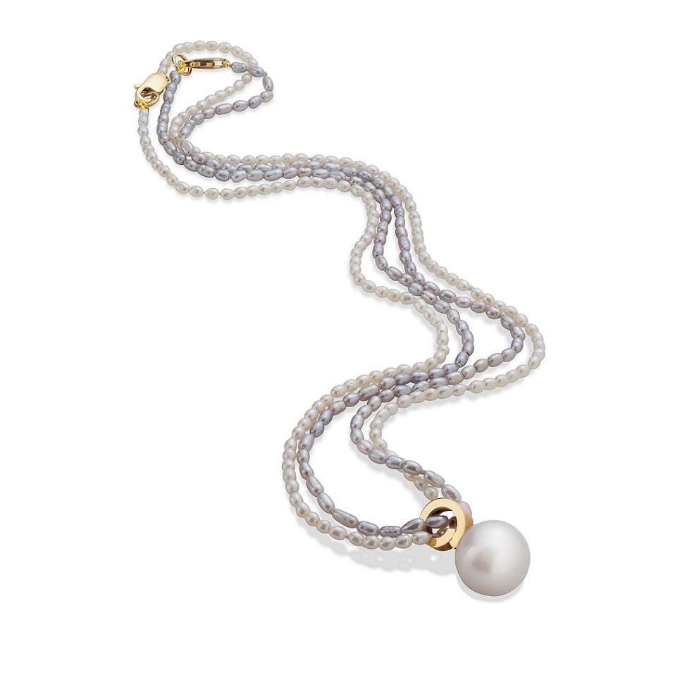 cirrus seed pearl strand with freshwater pearl 14k yellow gold detail