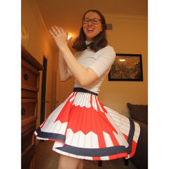 Erin clapping and twirling to show off the Mars 2020 parachute skirt