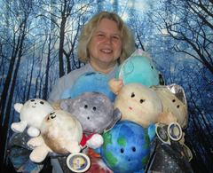 Noreen Grice holds several Celestial Buddies plush planet pals in front of a virtual forest background