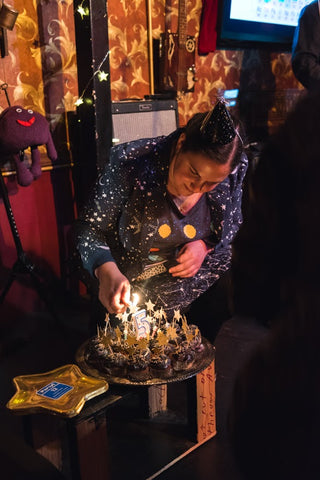 Sally starrider lighting candles on space cupcakes