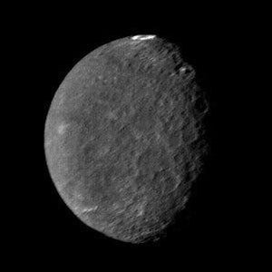 The southern hemisphere of Umbriel displays heavy cratering in this Voyager 2 image, taken Jan. 24, 1986, from a distance of 557,000 kilometers (346,000 miles). Image Credit: NASA/JPL