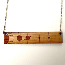 Load image into Gallery viewer, Solar System To Scale Horizontal Wood Necklace with Pluto