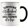 Surviving Motherhood One Meltdown at a Time Accent Mug Black - Tierra Bella