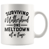 Surviving Motherhood One Meltdown at a Time Accent Mug White - Tierra Bella