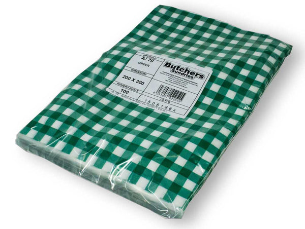 Wrapped green gingham vacuum pouches packed.