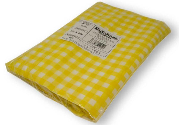 Wrapped yellow gingham vacuum pouches packed.
