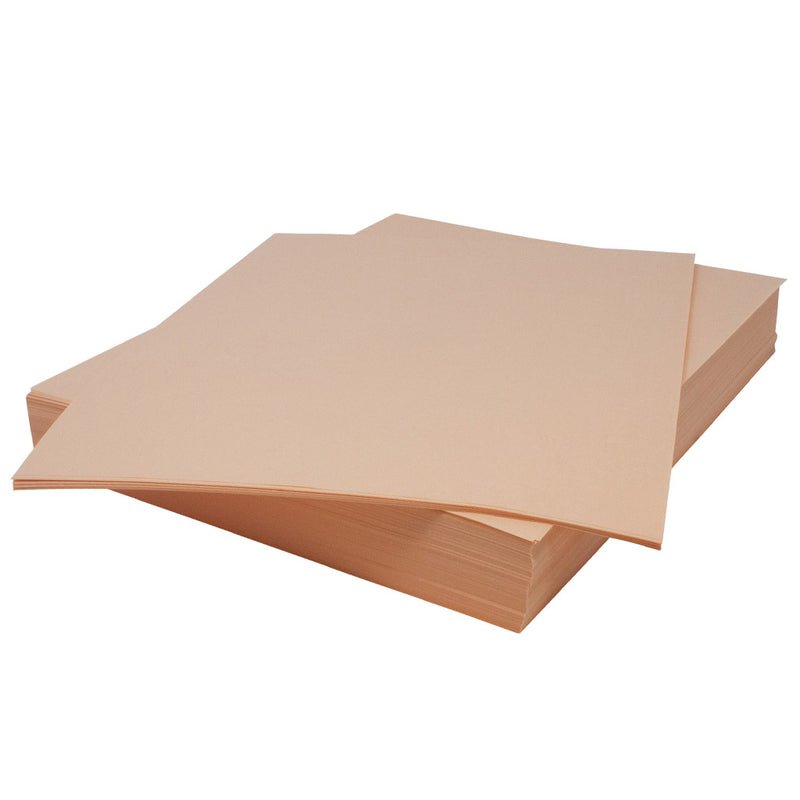 Stack of butchers peach paper on top of one another.