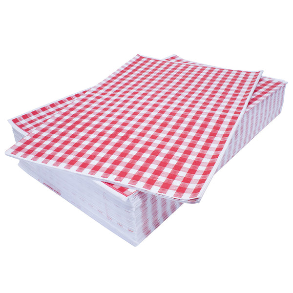 Stack of red gingham sheets on top of one another.