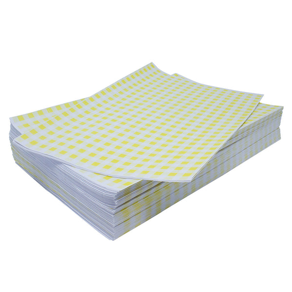 Stack of yellow gingham sheets on top of one another.