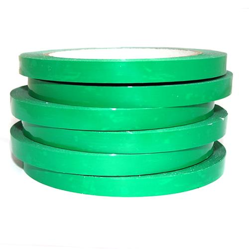Stack of 6 green bag sealing tapes on rolls.