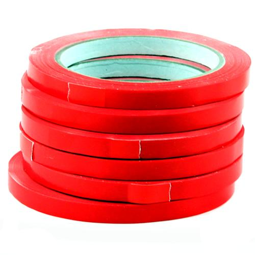 Stack of 6 red bag sealing tapes on rolls.