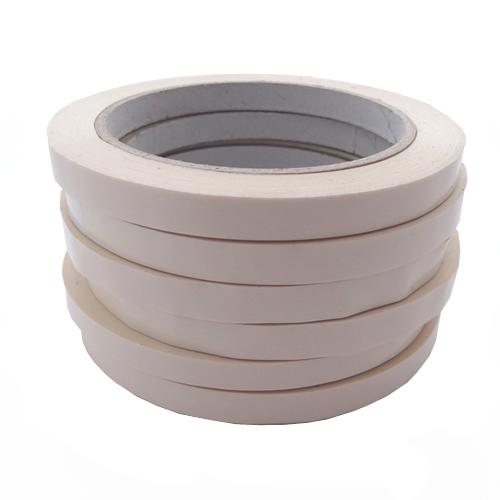 Stack of 6 white bag sealing tapes on rolls.
