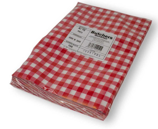 Wrapped red gingham vacuum pouches packed.