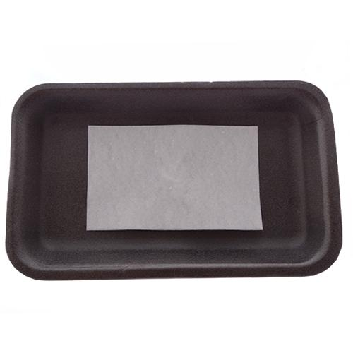 White meat saver soaker pad on black polystyrene tray.