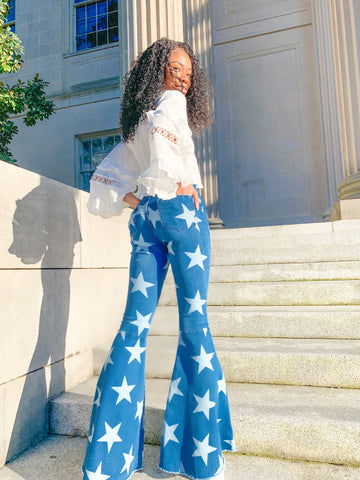 Star of the Show - Denim Star Printed Flare Jeans