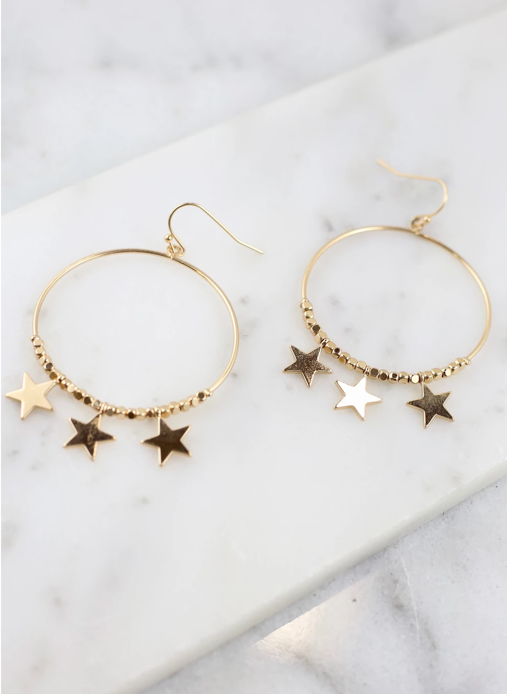 Stars In The City - Gold Hoops With Star Charms